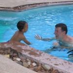 Amani akifurahi kwenye pool