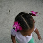 Malaika with Orchid flowers in her hair