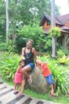 With my kids, behind is our hotel villa
