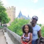 Behind us is very old castle, Segovia Spain