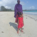 Malaika with Masai at Kipepeo Beach