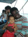 Baby Malaika with aunt Judy on the boat to Bongoyo Island