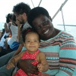 Baby Malaika with aunt Judy on the boat to Bongoyo Island