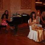 Malaika with musicians at Al Bustan Palace