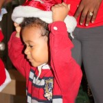 Our family Christmas tree day, Amani having fun
