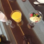 Smoothie of the day, orange juice and mix berries with mango muesli