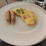 Moi plate, eggs omelet with robster and sausage