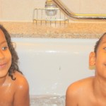 Bath time with my brother Amani