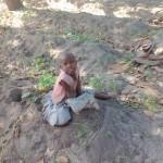 Karembo kalikua busy kuokota korosho. Very cute girl