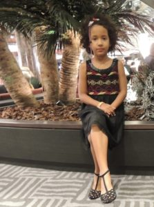 Binti Malaika at MSC Divina lobby